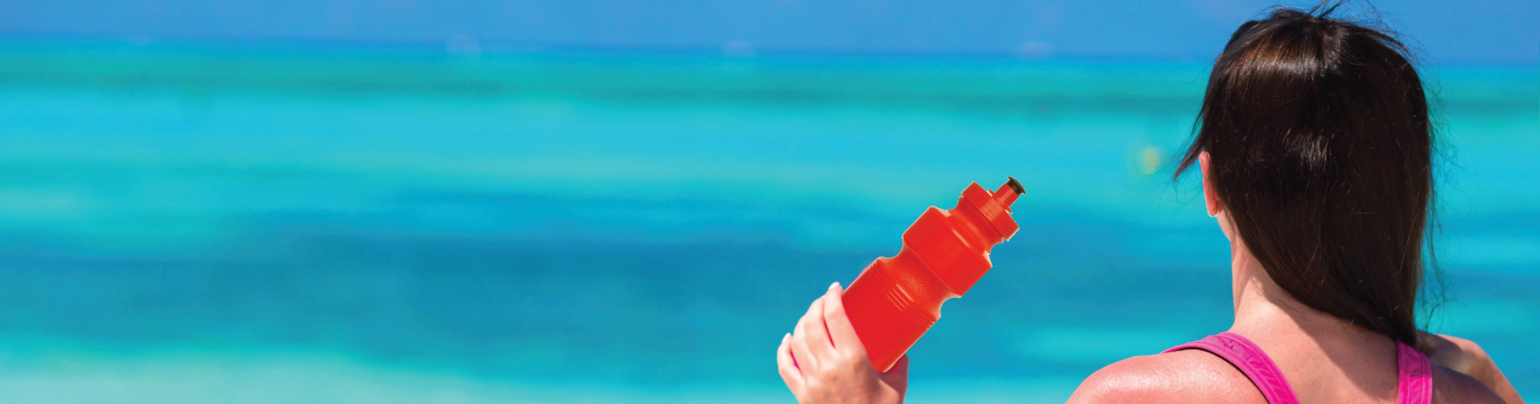 sports water bottles while at the beach